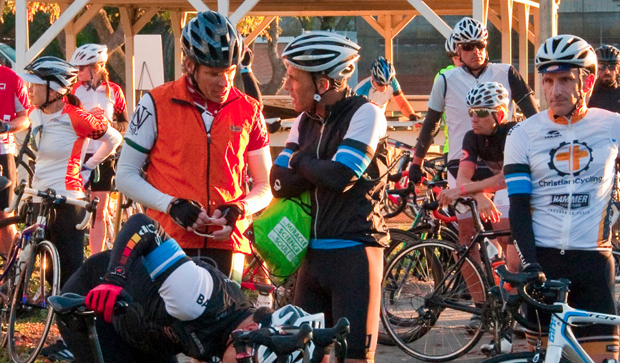 Group of cyclist in a discussion